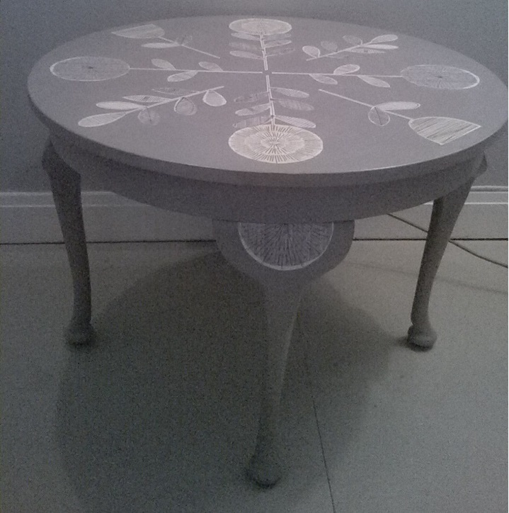 upcycled round table with decoupage design
